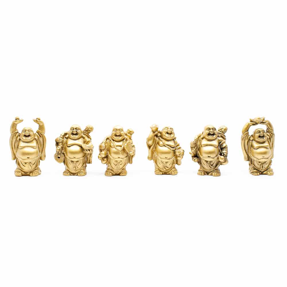 gouden mini beeldjes op een rijtje